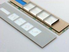 zdjęcie 16 - rezystancyjny panel dotykowy z graficznym podziałem na klawisze/pola dotykowe. Dodatkowa konstrukcja do krawędziowego podświetlenia pól dotykowych.